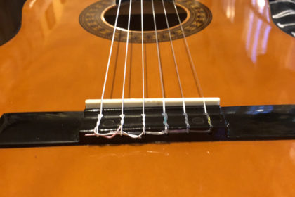 Classical guitar stringing - not bad for a first try!